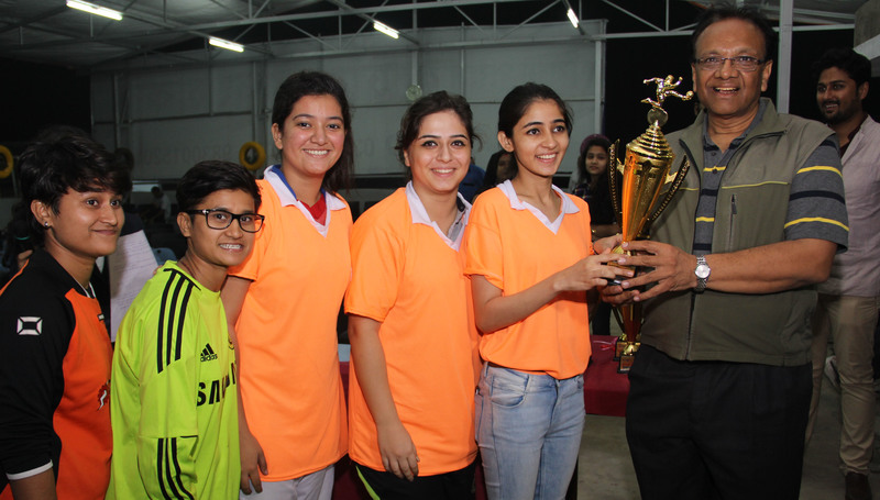iLEAD Women's team with the champions trophy.